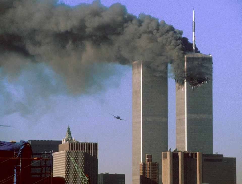 "Hijacked United Airlines Flight 175 (L) flies toward the World Trade Center twin towers shortly before slamming into the south tower (L) as the north tower burns following an earlier attack by a hijacked airliner in New York City September 11, 2001. The stunning aerial assaults on the huge commercial complex where more than 40,000 people worked on an ordinary day were part of a coordinated attack aimed at the nation's financial heart. They destroyed one of America's most dramatic symbols of power and financial strength and left New York reeling. <br><br>(REUTERS/STR New)<a href=""http://www.life.com/gallery/59971/911-the-25-most-powerful-photos#index/0"" rel=""nofollow noopener"" target=""_blank"" data-ylk=""slk:"" class=""link rapid-noclick-resp""><br></a>"