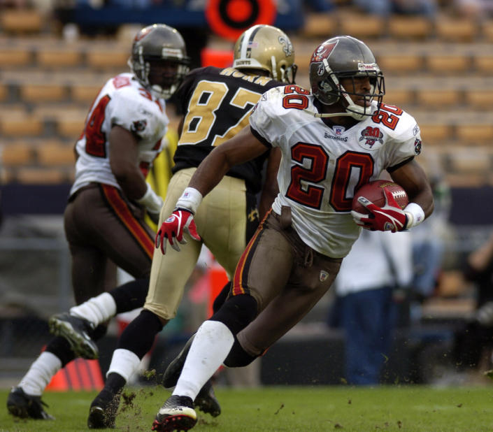 FILE - In this Dec. 4, 2005, file photo, Tampa Bay Buccaneers cornerback Ronde Barber runs the ball after making an interception in the closing minutes of an NFL football game against New Orleans Saints in Baton Rouge, La. Barber was selected as a finalist for the Pro Football Hall of Fame's class of 2021 on Tuesday, Jan. 5, 2021. (AP Photo/Paul Rutherford, File)