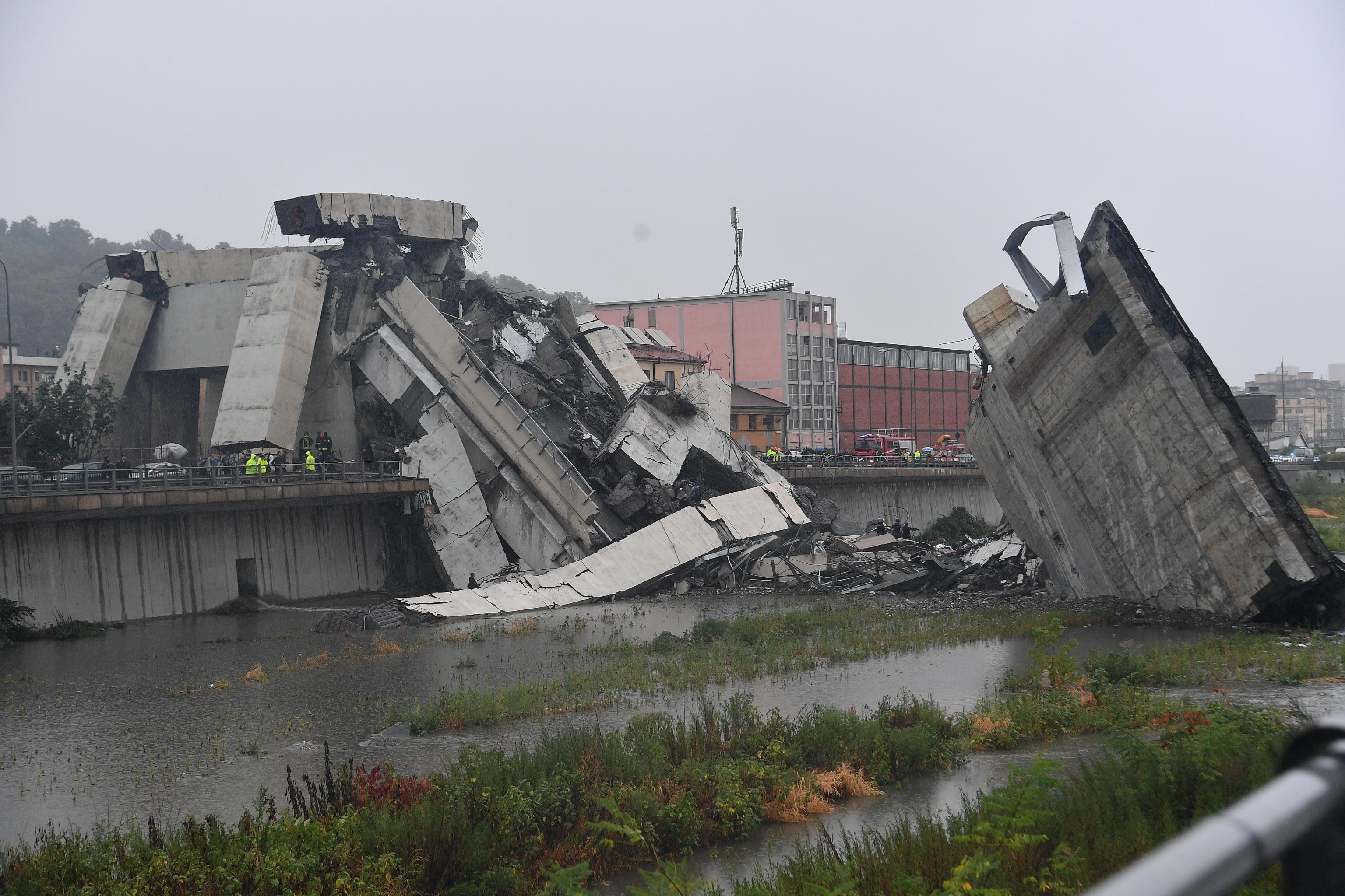 Image result for 26 people killed as they plummeted to the ground or were crushed by debris when bridge collapsed in Genoa