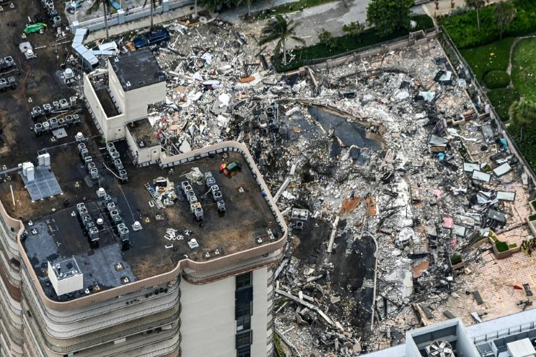 An aerial view shows the extent of the destruction after an apartment building pancaked in Miami on June 24 2021