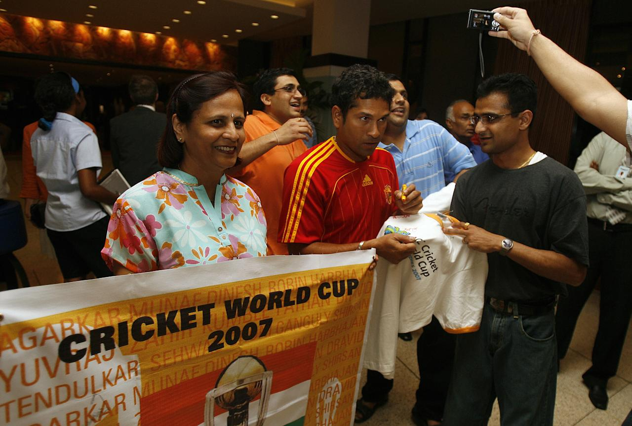 Port-of-Spain, TRINIDAD AND TOBAGO: India cricketer Sachin Tendulkar (C) signs autographs for Indian fans at the Hilton hotel in Port-of-Spain, in Trinidad and Tobago, 16 March 2007. India will play its first Group Stage match against Bangladesh at Queen's Park Oval in Port-of-Spain on 17 March. AFP PHOTO/Prakash SINGH (Photo credit should read PRAKASH SINGH/AFP/Getty Images)