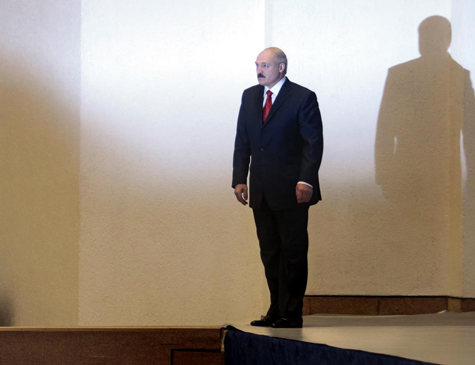 FILE - In this Dec. 20, 2010, file photo, incumbent Belarusian President Alexander Lukashenko stands before a news conference after preliminary election results show him overwhelmingly winning a fourth term in Minsk, Berlarus. When Lukashenko became president in 1994, Belarus was an obscure country that had not even existed for three years. Over the next quarter-century, he brought it to the world's notice via dramatic repression, erratic behavior and colorful threats. (AP Photo/File)