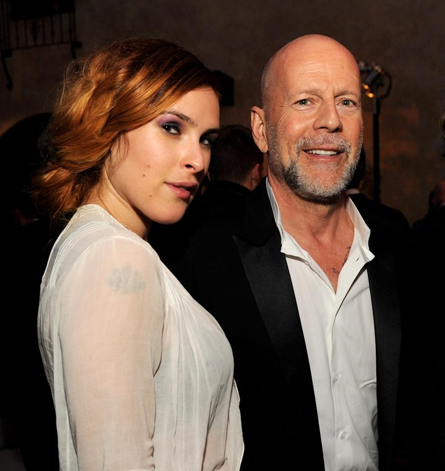 "LOS ANGELES, CA - MARCH 28:  Actor Bruce Willis (R) and his daughter actress Rumer Willis pose at the after party for the premiere of Paramount Pictures' ""G.I. Joe: Retaliation"" at the Roosevelt Hotel on March 28, 2013 in Los Angeles, California.  (Photo by Kevin Winter/Getty Images)"