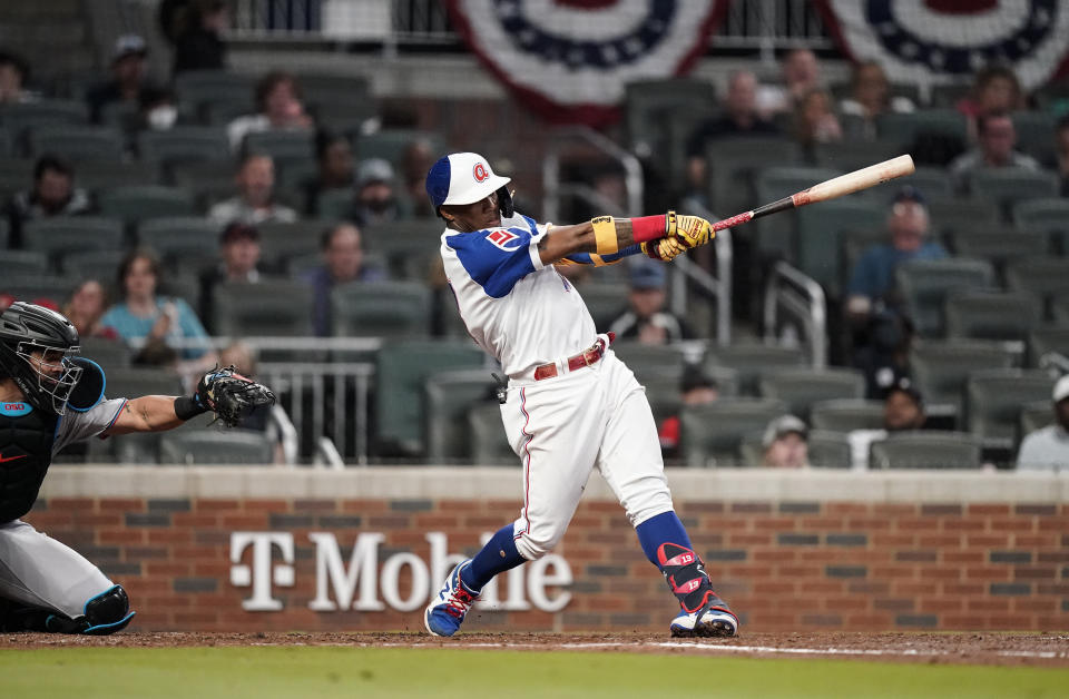 Atlanta Braves' Ronald Acuna Jr., hits a home run in the third inning of the team's baseball game against the Miami Marlins on Wednesday, April 14, 2021, in Atlanta. (AP Photo/Brynn Anderson)