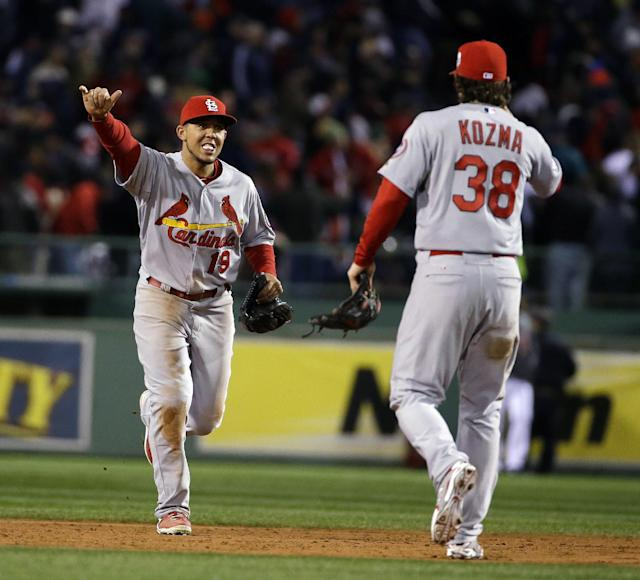 St. Louis Cardinals' Jon Jay and Pete Kozma (38) celebrate after the Cardinals defeated the Boston Red Sox, 4-2, in Game 2 of baseball's World Series Thursday, Oct. 24, 2013, in Boston. The series is tied at 1-1. (AP Photo/Matt Slocum)