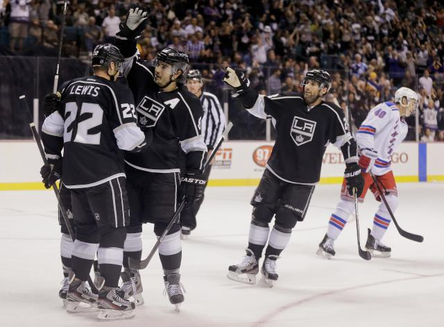 Los Angeles Kings defenseman Drew Doughty (8) congratulates Los Angeles Kings center Trevor Lewis (22) after Lewis scored a goal against the New York Rangers in the second period of a preseason NHL hockey game, Friday, Sept. 27, 2013 in Las Vegas. (AP Photo/Julie Jacobson)