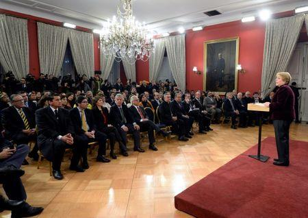 """Chile's President Michelle Bachelet delivers a message asking for forgiveness from Chile's indigenous Mapuche people for """"errors and horrors"""" committed by the state and announcing plans to give them more power and resources, at the government house in Santiago, Chile June 23, 2017. Alex Ibanez/Courtesy of Chilean Presidency/Handout via Reuters"""