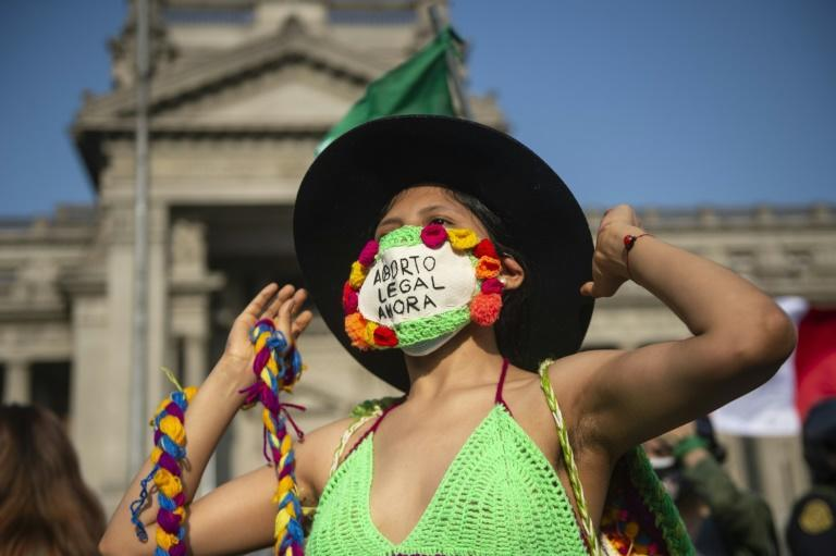 Activists demanding abortion rights rally outside the Justice Palace in Lima (AFP/Ernesto BENAVIDES)