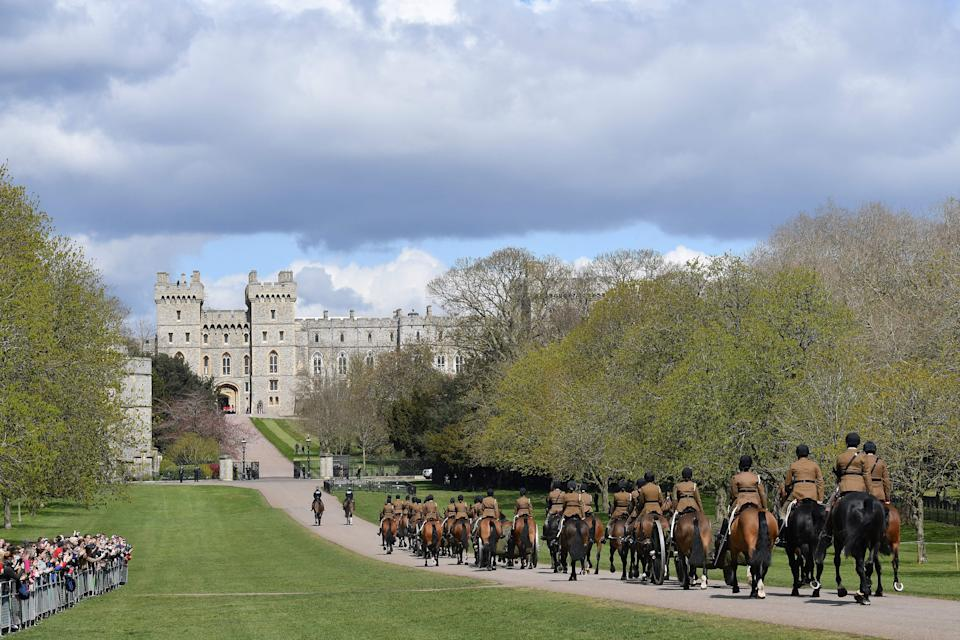 TOPSHOT - Members of the Kings Troop Royal Horse Artillery ride their horses into the grounds of Windsor Castle in Windsor, west of London, on April 15, 2021, following the April 9 death of Britain's Prince Philip, Duke of Edinburgh, at the age of 99. - Prince Philip's funeral will take place at St George's Chapel, Windsor Castle on Saturday, April 17. (Photo by JUSTIN TALLIS / AFP) / The erroneous mention[s] appearing in the metadata of this photo by JUSTIN TALLIS has been modified in AFP systems in the following manner: [Members of the Kings Troop Royal Horse Artillery] instead of [Members of the Household Cavalry Mounted Regiment]. Please immediately remove the erroneous mention[s] from all your online services and delete it (them) from your servers. If you have been authorized by AFP to distribute it (them) to third parties, please ensure that the same actions are carried out by them. Failure to promptly comply with these instructions will entail liability on your part for any continued or post notification usage. Therefore we thank you very much for all your attention and prompt action. We are sorry for the inconvenience this notification may cause and remain at your disposal for any further information you may require. (Photo by JUSTIN TALLIS/AFP via Getty Images)