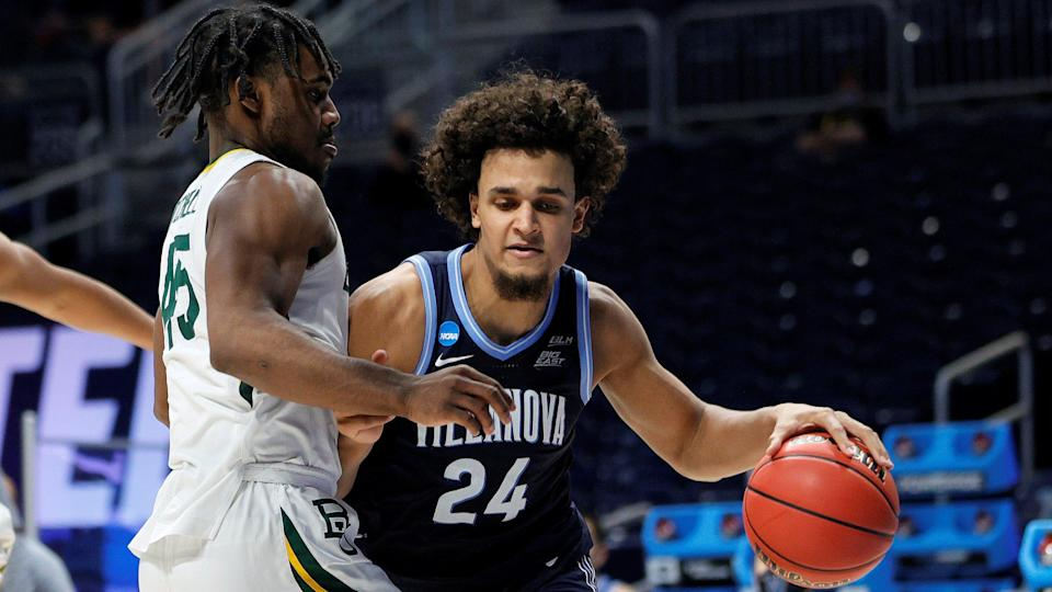 INDIANAPOLIS, INDIANA - MARCH 27: Jeremiah Robinson-Earl #24 of the Villanova Wildcats drives with the ball against Davion Mitchell #45 of the Baylor Bears in the second half of their Sweet Sixteen game of the 2021 NCAA Men's Basketball Tournament at Hinkle Fieldhouse on March 27, 2021 in Indianapolis, Indiana. (Photo by Sarah Stier/Getty Images) ORG XMIT: 775630341 ORIG FILE ID: 1309483711