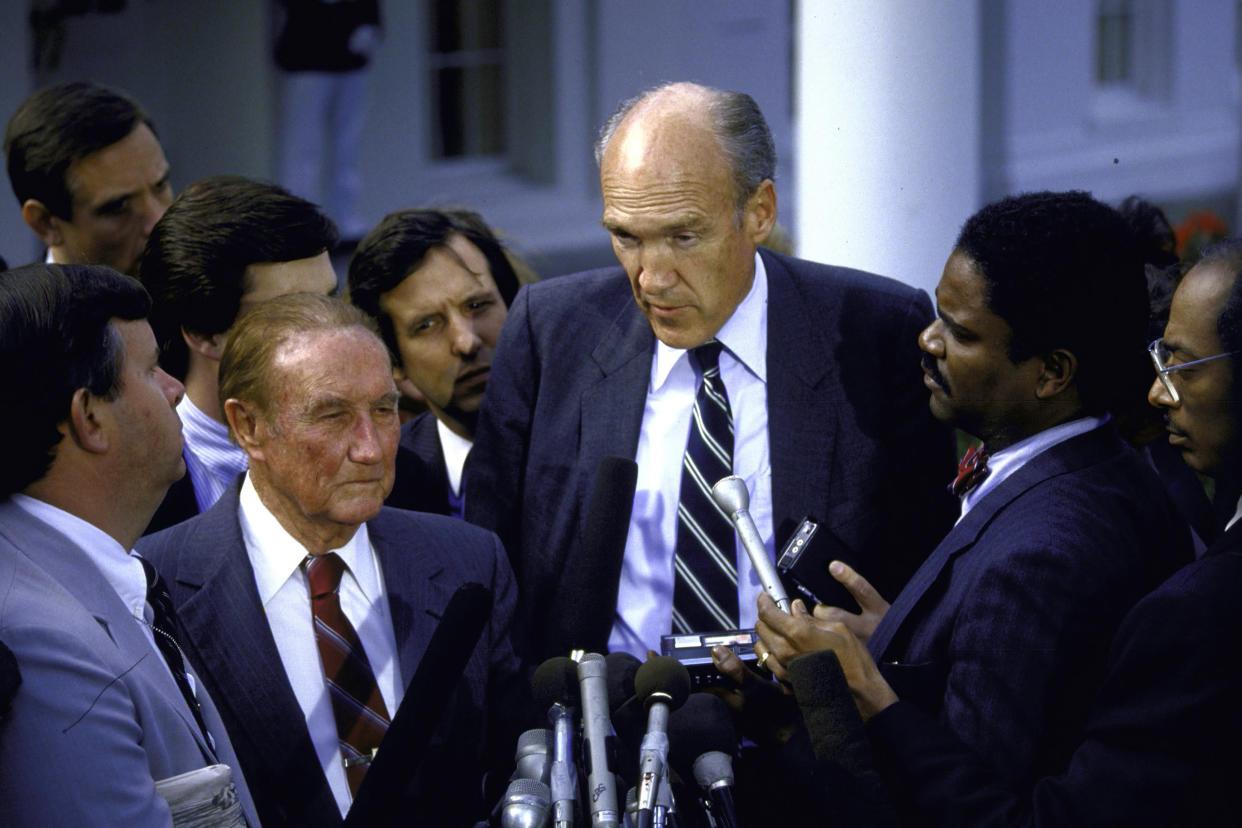 Senators J. Strom Thurmond and Alan Simpson walking through a mob of reporters after a White House meeting concerning Robert H. Bork's Supreme Court nomination. (Photo: Diana Walker//Time & Life Pictures/Getty Images)