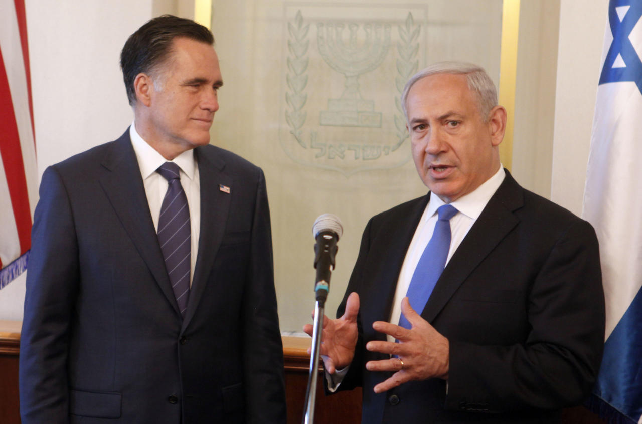 Israeli Prime Minister Benjamin Netanyahu, right, and US Republican presidential candidate Mitt Romney meet at the Prime Minister's office in Jerusalem, Sunday, July 29, 2012. Romney would back an Israeli military strike against Iran aimed at preventing Tehran from obtaining nuclear capability, a top foreign policy adviser said early Sunday, outlining the aggressive posture the Republican presidential candidate will take toward Iran in a speech in Israel later in the day. (AP Photo/Lior Mizrahi, Pool)