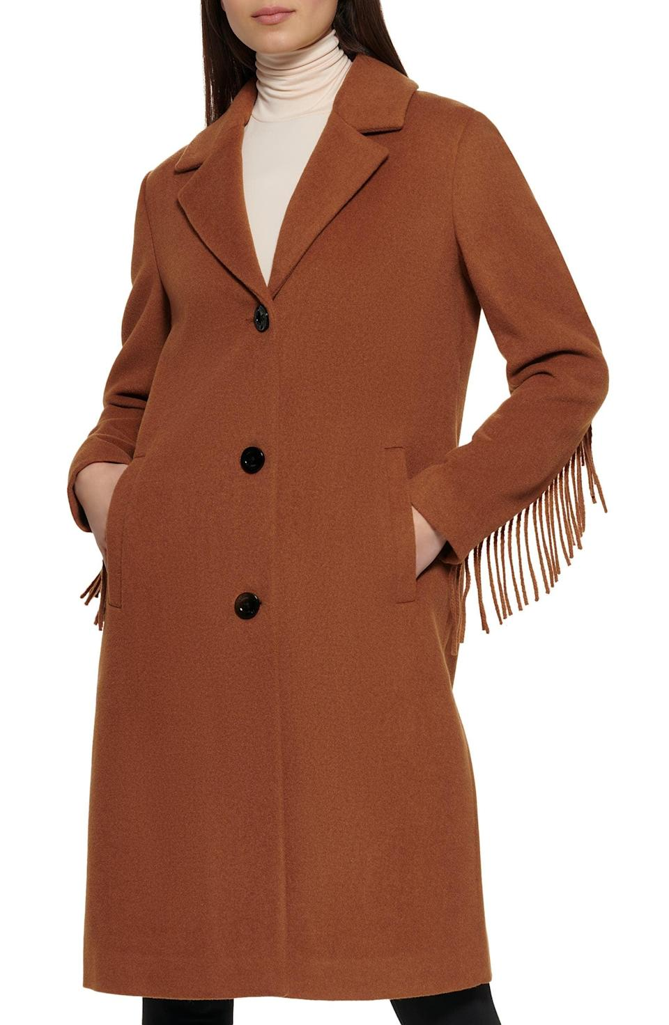 <p>This <span>Kenneth Cole New York Notched Collar Wool Blend Fringe Coat</span> ($179, originally $250) will keep you warm and cozy when temperatures start to dip. We love the fringe on the sleeve.</p>