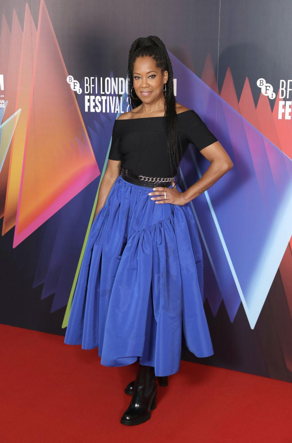 <p>Earlier that day, Regina King attended a press conference for The Harder They Fall in a blue flared skirt and off the shoulder top by Alexander McQueen. </p>