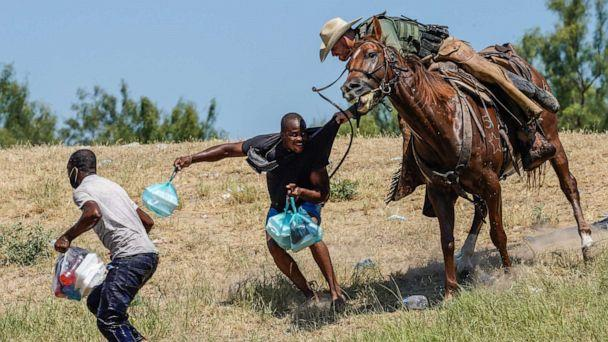 PHOTO: A United States Border Patrol agent on horseback tries to stop a Haitian migrant from entering an encampment on the banks of the Rio Grande near the Acuna Del Rio International Bridge in Del Rio, Texas, Sept. 19, 2021. (Paul Ratje/AFP via Getty Images)