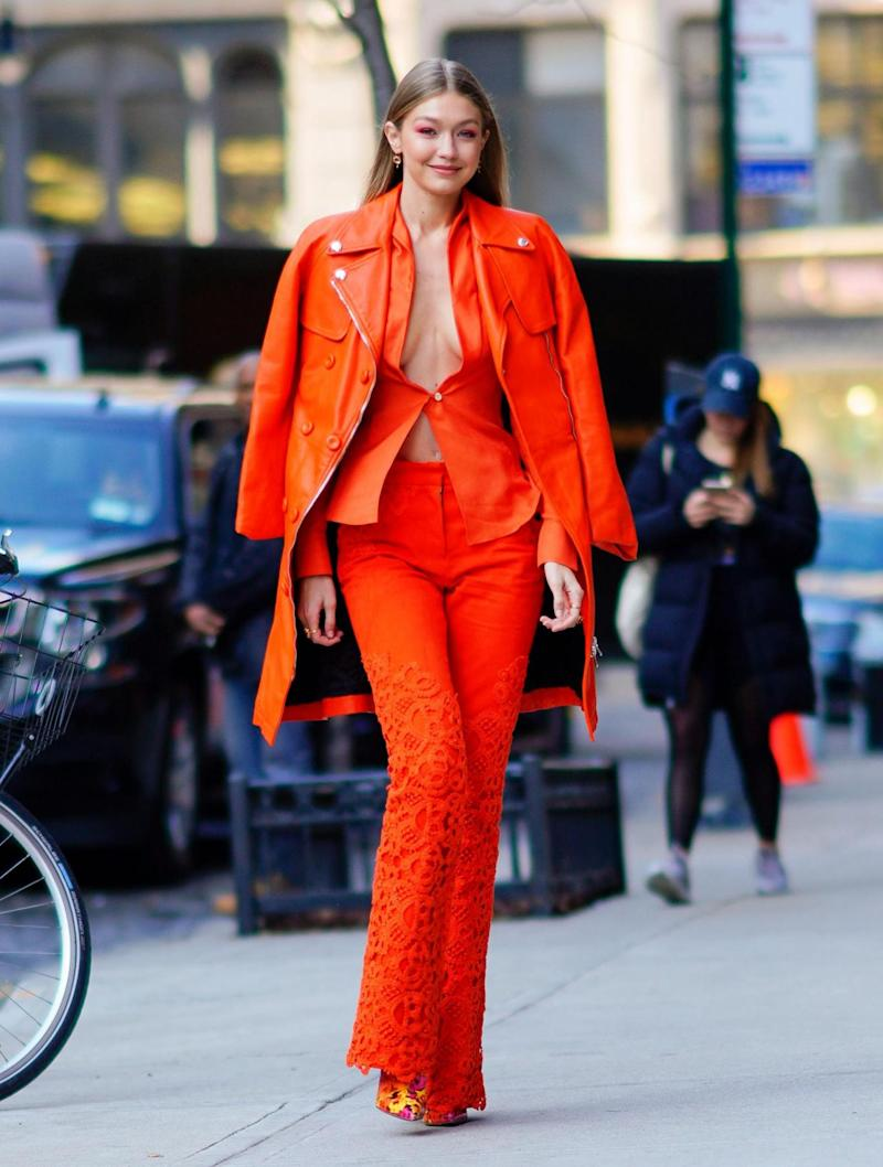 Gigi Hadid wears a bright orange outfit in New York (SplashNews.com)