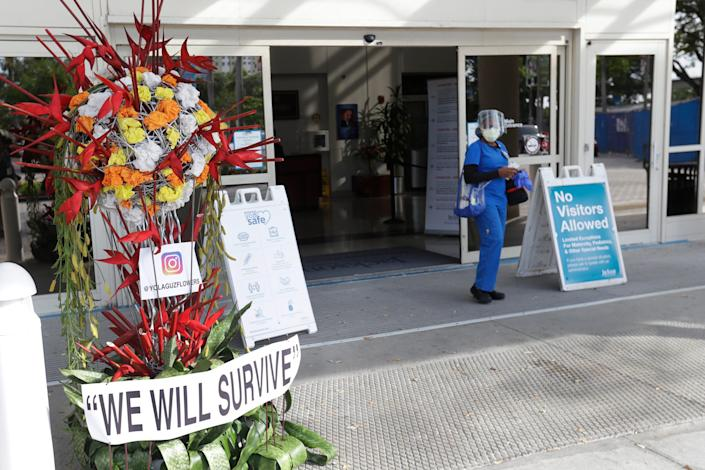 A floral arrangement outside Jackson Memorial Hospital in Miami expresses the determination to weather a rapid rise in coronavirus cases in Florida.