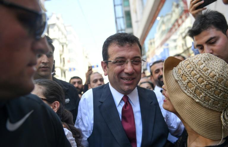 Social media users lashed out at CNN Turk after it stopped an interview with Ekrem Imamoglu (C) half an hour ahead of schedule