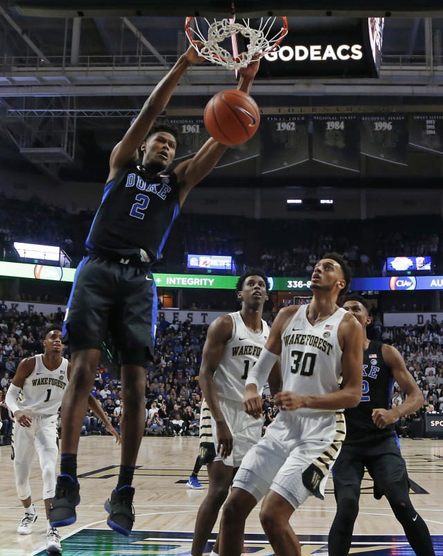 Duke's Cam Reddish (2) dunks past Wake Forest's Olivier Sarr (30) during the first half of an NCAA college basketball game in Winston-Salem, N.C., Tuesday, Jan. 8, 2019. (AP Photo/Chuck Burton)