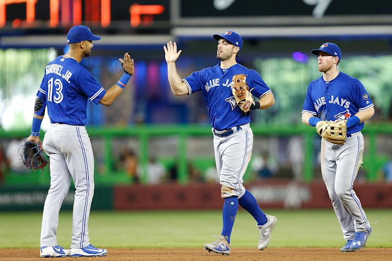 MIAMI, FL - SEPTEMBER 02: Randal Grichuk #15 of the Toronto Blue Jays celebrates with Lourdes Gurriel Jr. #13 after they defeated the Miami Marlins 6-1 at Marlins Park on September 2, 2018 in Miami, Florida. (Photo by Michael Reaves/Getty Images)