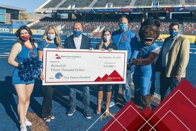 Jason Smith and Angie Phillips of Mountain America present the check to Bob Carney and Sara Swanson of Boise State Athletics at Boise State University.