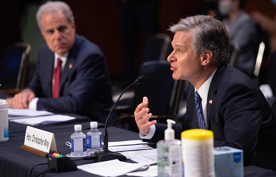 FBI Director Christopher Wray, right, and Department of Justice Inspector General Michael Horowitz testify Wednesday during a Senate Judiciary Committee hearing about the handling of the Larry Nassar investigation of sexual abuse of gymnasts.