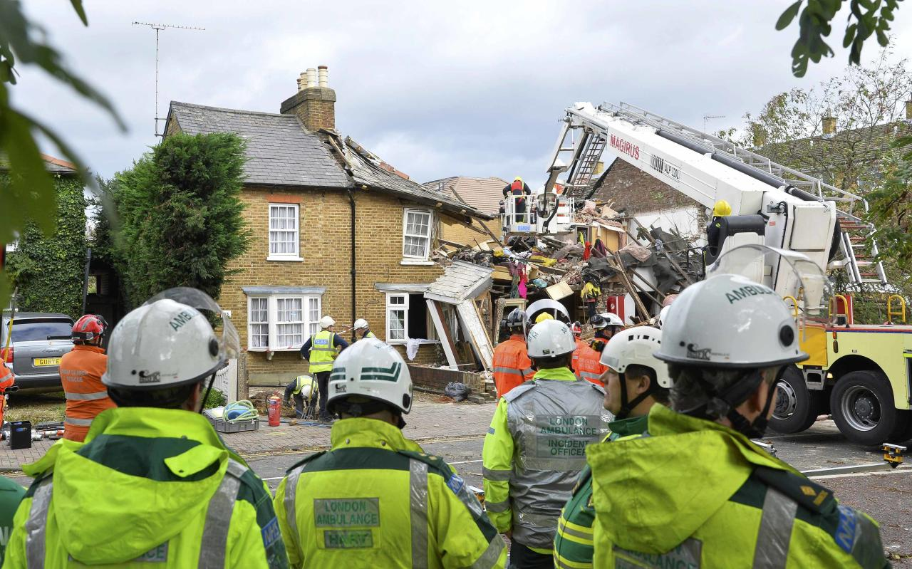 Emergency services work at the scene of a fallen tree in Hounslow, west London
