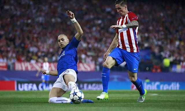 """<span class=""""element-image__caption"""">Leicester's Yohan Benalouane, who made some timely interceptions after starting in place of the injured Wes Morgan, makes a sliding tackle on Fernando Torres of of Atlético Madrid.</span> <span class=""""element-image__credit"""">Photograph: Gonzalo Arroyo Moreno/Getty Images</span>"""