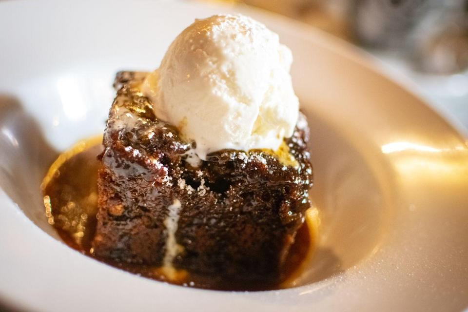 """<p>Sticky toffee pudding is quintessentially British, and one of our FAVOURITE desserts. Serve with ice cream, obvs. </p><p><br>Find the recipe from <a href=""""https://www.delish.com/uk/cooking/recipes/a28924397/sticky-toffee-pudding-recipe/"""" rel=""""nofollow noopener"""" target=""""_blank"""" data-ylk=""""slk:Delish"""" class=""""link rapid-noclick-resp"""">Delish</a>.</p>"""