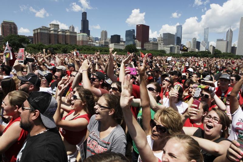 Fans cheer during a rally in Grant Park for the NHL Stanley Cup hockey champion Chicago Blackhawks on Friday, June 28, 2013, in Chicago. (AP Photo/M. Spencer Green)