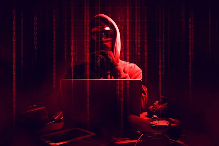 """<span class=""""caption"""">Cybercriminals view colleges as high-value targets. </span> <span class=""""attribution""""><a class=""""link rapid-noclick-resp"""" href=""""https://www.gettyimages.com/detail/photo/digital-composite-image-of-male-hacker-using-laptop-royalty-free-image/1191871809?adppopup=true"""" rel=""""nofollow noopener"""" target=""""_blank"""" data-ylk=""""slk:Issaro Prakalung / EyeEm/GettyImages"""">Issaro Prakalung / EyeEm/GettyImages</a></span>"""