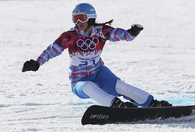 Russia's Alena Zavarzina competes in the small final to take the bronze medal in the women's snowboard parallel giant slalom at the Rosa Khutor Extreme Park, at the 2014 Winter Olympics, Wednesday, Feb. 19, 2014, in Krasnaya Polyana, Russia. (AP Photo/Sergei Grits)