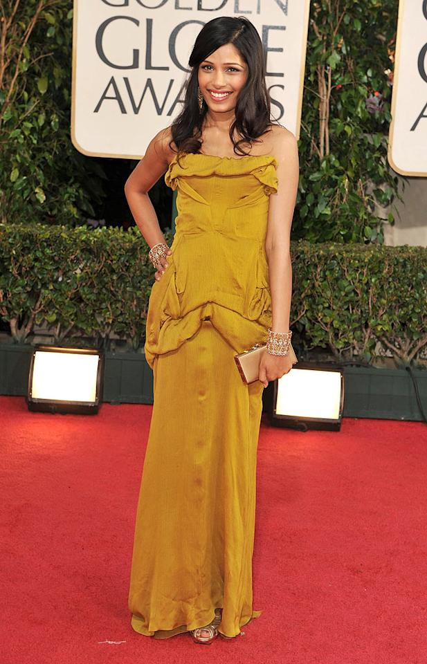 "Freida Pinto (""Slumdog Millionaire"") was simply gorgeous in her golden gown. Steve Granitz/<a href=""http://www.wireimage.com"" target=""new"">WireImage.com</a> - January 11, 2009"