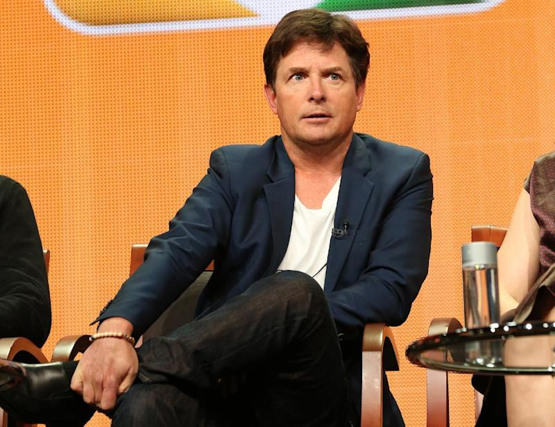 """FILE - This July 27, 2013 file publicity image released by NBC shows actor Michael J. Fox from the """"The Michael J. Fox Show"""" panel during the NBCUniversal Press Tour in Beverly Hills, Calif. Fox will star as Mike Henry, a former local NBC newscaster with Parkinson's. (AP Photo/NBC, Chris Haston)"""