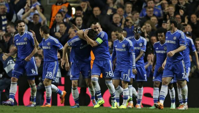 Chelsea's Gary Cahill, centre left, celebrates with John Terry after scoring his sides second goal during the Champions League round of 16 second leg soccer match between Chelsea and Galatasaray at Stamford Bridge stadium in London Tuesday, March 18, 2014. (AP Photo/Kirsty Wigglesworth)