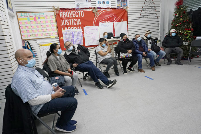 A group of immigrants gather at the Workers Justice Center as they watch Joe Biden's presidential inauguration, Wednesday, Jan. 20, 2021, in the Sunset Park neighborhood of Brooklyn in New York. Most were disappointed Biden didn't mention immigration reform in his inaugural speech. (AP Photo/Kathy Willens)
