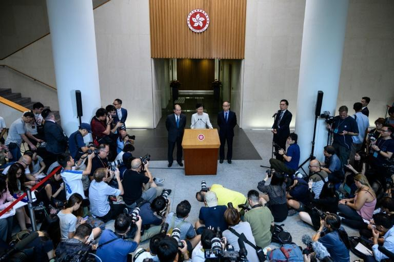 Hong Kong leader calls for dialogue after protesters reject concession