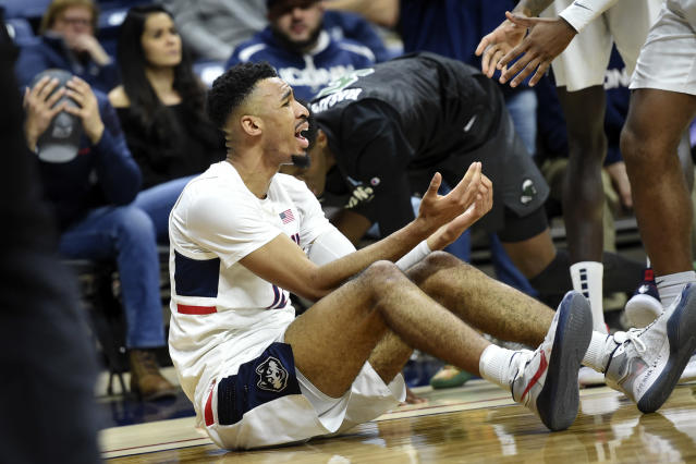 Connecticut's Tyler Polley questions an out-of-bounds call during the second half of the team's NCAA college basketball game against Tulane on Wednesday, Jan. 8, 2020, in Storrs, Conn. (AP Photo/Stephen Dunn)