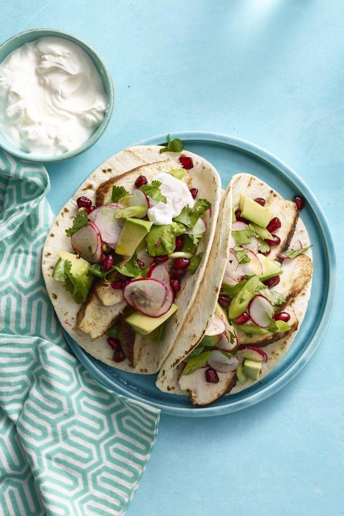 """<p>In just 20 minutes, you'll have a meal that will really wow. If you'd like, add eggs to the tacos to make it really say <em>brunch</em>.</p><p><strong><em><a href=""""https://www.womansday.com/food-recipes/food-drinks/recipes/a13250/spiced-chicken-tacos-avocado-pomegranate-salsa-recipe-wdy0315/"""" rel=""""nofollow noopener"""" target=""""_blank"""" data-ylk=""""slk:Get the Spiced Chicken Tacos with Avocado and Pomegranate Salsa recipe."""" class=""""link rapid-noclick-resp"""">Get the Spiced Chicken Tacos with Avocado and Pomegranate Salsa recipe. </a></em></strong></p>"""