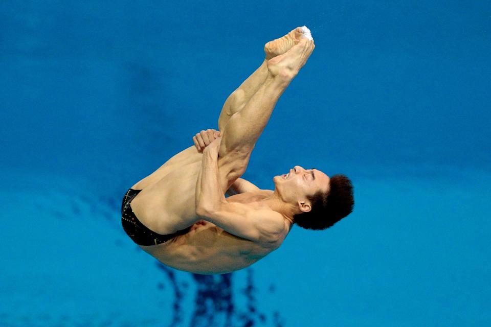 LONDON, ENGLAND - AUGUST 07: Kai Qin of China competes in the Men's 3m Springboard Diving Final on Day 11 of the London 2012 Olympic Games at the Aquatics Centre on August 7, 2012 in London, England. (Photo by Adam Pretty/Getty Images)
