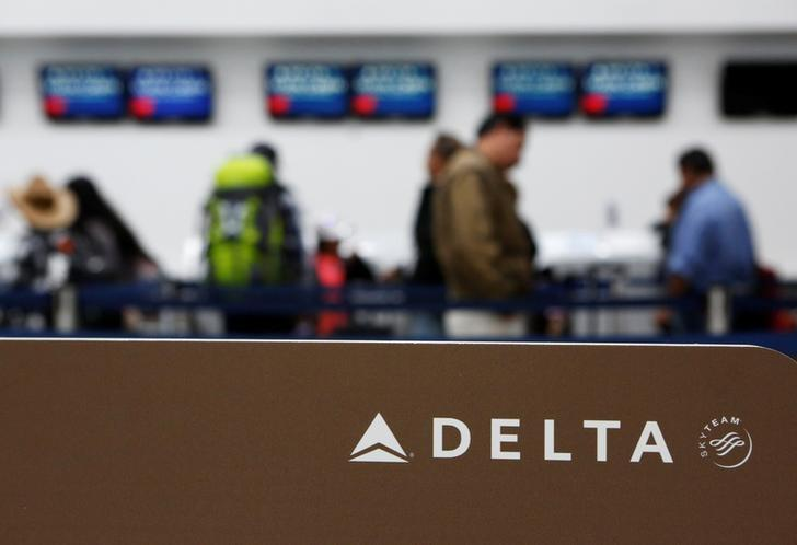 FILE PHOTO - Passengers check in at a counter of Delta Air Lines in Mexico City