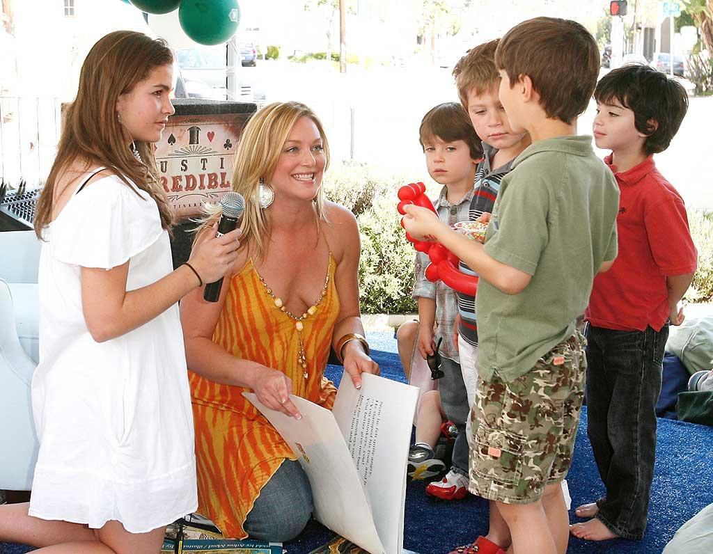 "Mom-to-be Elisabeth Rohm (""Law & Order"") brushes up on her reading skills. Donato Sardella/<a href=""http://www.wireimage.com"" target=""new"">WireImage.com</a> - March 9, 2008"