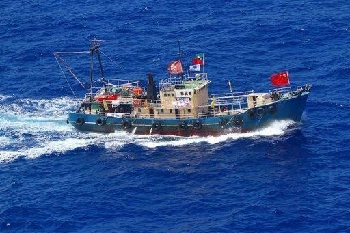 This picture taken by Japan Coast Guard shows a Hong Kong boat near disputed islands in the East China Sea. Japan has made 14 arrests after pro-China activists landed on an island at the centre of a bitter territorial dispute, in an episode that threatens to further destabilise fractious relations