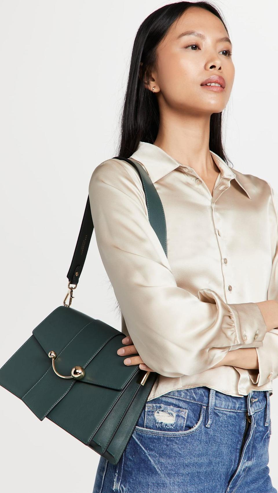 <p>We love the dark green hue of this <span>Strathberry Crescent Bag</span> ($745). It comes with a shoulder strap and long chain crossbody, so it can be worn multiple ways.</p>