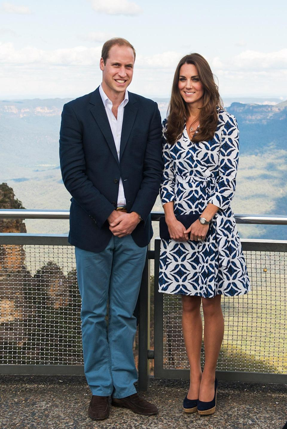 <p>Kate and William visited Australia's Blue Mountains with the Duchess donning a printed dress from Diane von Furstenberg. Navy wedges by Corkswoon and a Stuart Weitzman bag finished the look.</p><p><i>[Photo: PA]</i></p>