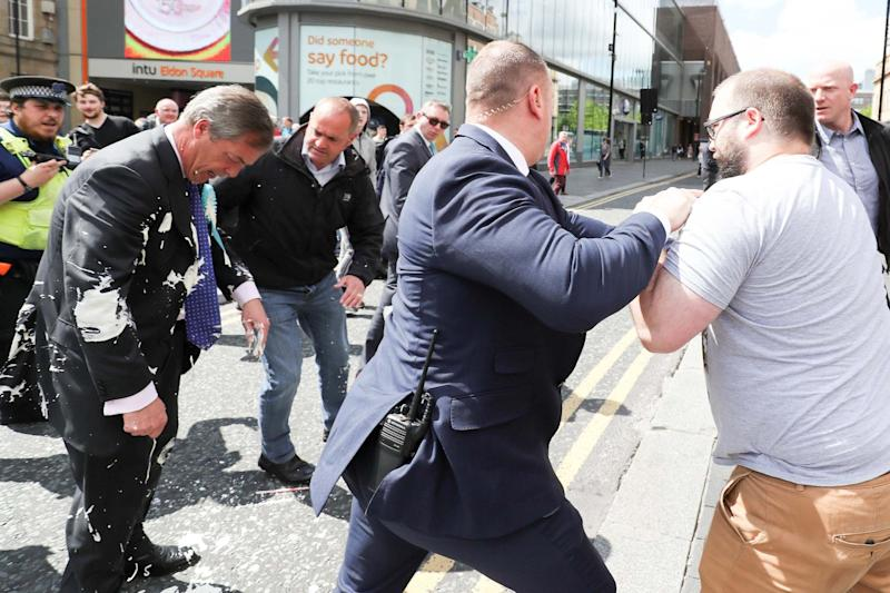 The moment Crowther threw the milkshake at Mr Farage (REUTERS)