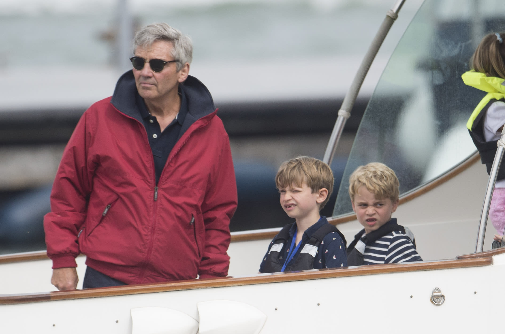 COWES, ENGLAND - AUGUST 08: Michael Middleton (L) with Prince George (R) at The Royal Yacht Squadron during the inaugural Kings Cup regatta hosted by the Duke and Duchess of Cambridge on August 08, 2019 in Cowes, England. Their Royal Highnesses hope that The Kings Cup will become an annual event bringing greater awareness to the wider benefits of sport, whilst also raising support and funds for Action on Addiction, Place2Be, the Anna Freud National Centre for Children and Families, The Royal Foundation, Child Bereavement UK, Centrepoint, Londonís Air Ambulance Charity and Tusk. on August 08, 2019 in Cowes, England. (Photo by Antony Jones/Getty Images)