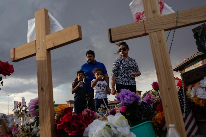 The Valenzuela family visits a makeshift memorial for victims of the shooting that killed 22 people at a Walmart store, in El Paso, Texas, Aug. 27, 2019. (Tamir Kalifa/The New York Times)