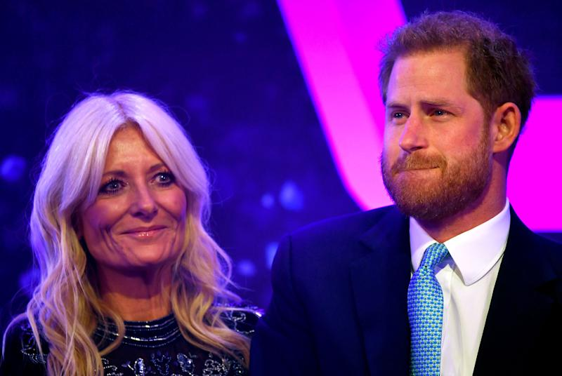 Britain's Prince Harry, Duke of Sussex (R) stands alongside television presenter Gaby Roslin as he delivers a speech during the annual WellChild Awards in London on October 15, 2019. - WellChild is the national charity for seriously ill children and their families. The WellChild Awards celebrate the inspiring qualities of some of the country's seriously ill young people and the dedication of those who care for and support them. (Photo by TOBY MELVILLE / POOL / AFP) (Photo by TOBY MELVILLE/POOL/AFP via Getty Images)