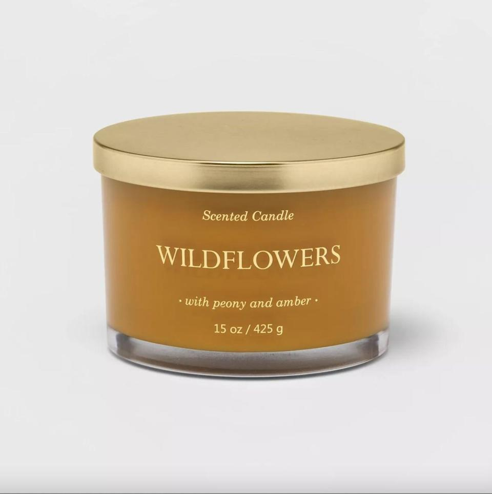 <p>With notes of peony and amber, this <span>Wildflowers Lidded Glass Jar Solid Color 3-Wick Candle</span> ($10) will bring a warm ambience to your space.</p>